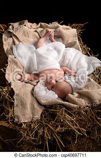 Jesus Resting on a Manger - csp40697711