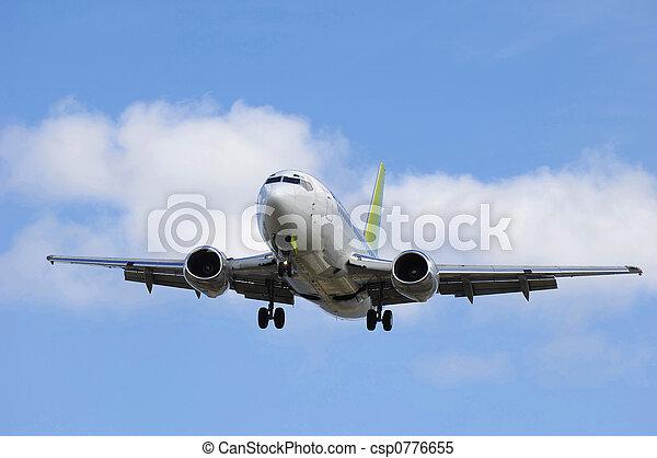 Jet plane going to land - csp0776655