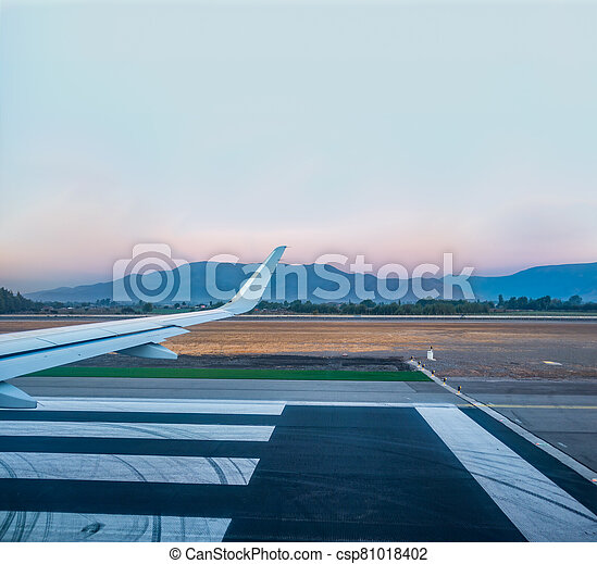Jet wing prepared for takeoff on runway - csp81018402