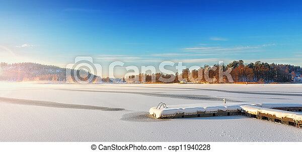 Jetty in a winter landscape - csp11940228