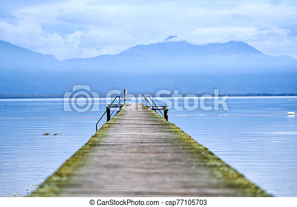 Jetty in the middle of a lake - csp77105703