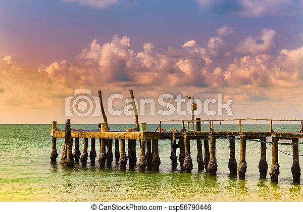Jetty over seacoast skyline sunset tone - csp56790446