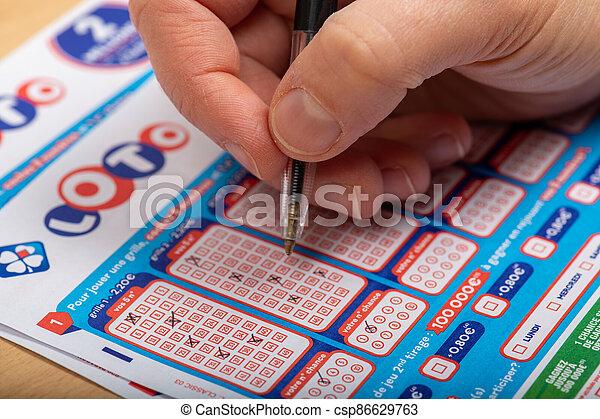 jeux), francaise, aperson, -, novembre, paris, remplissage, (la, closeup, france, société, grille, :, 21, 2019, loto, fdj, from - csp86629763