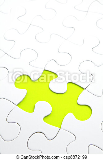 Jigsaw puzzle with green piece missed - csp8872199