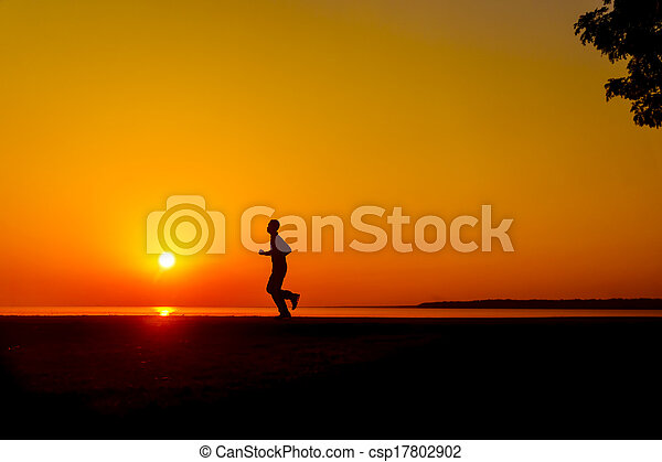 jogging at sunset - csp17802902