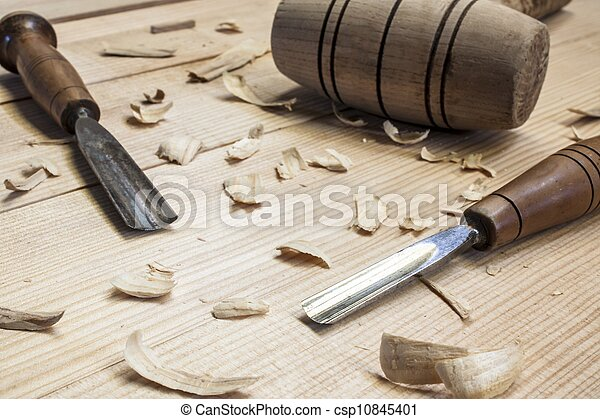 Joiner tools, hammer and chisel on wood table background ...
