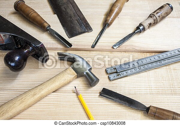 Joiner tools,hammer chisel and meter on wood table background.