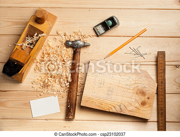 joinery tools on wood table background with business card - csp23102037