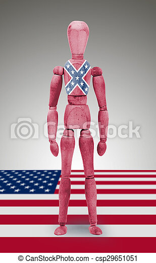 Jointed wooden mannequin isolated on white background, Confederate flag - csp29651051
