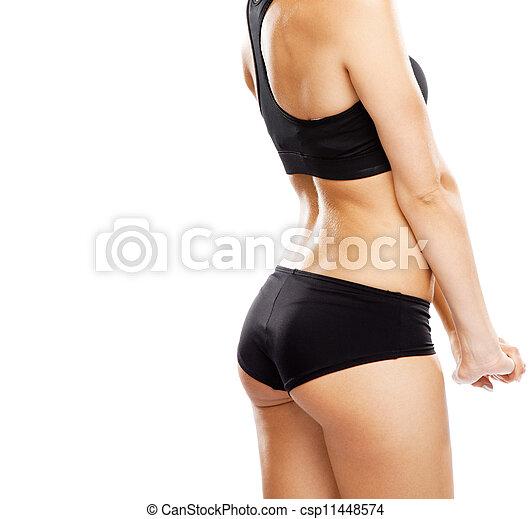 Una mujer joven con traje deportivo - csp11448574