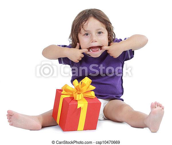 Joyful boy with present box - csp10470669
