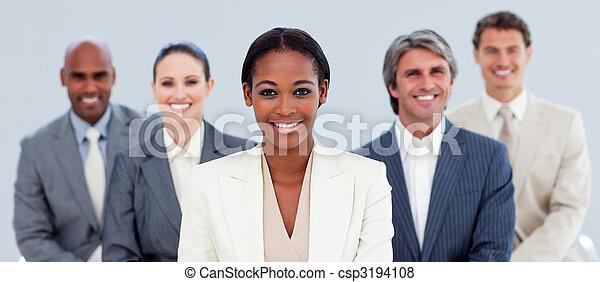 Joyful business team standing in the meeting room - csp3194108