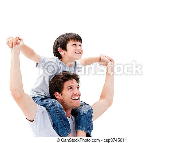 Joyful father giving piggyback ride to his son - csp3745011