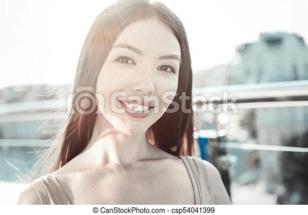 Joyful Kind Girl Looking Straight And Smiling Csp
