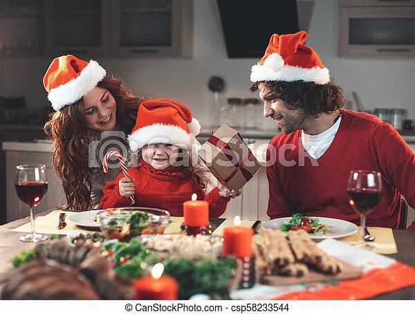 Joyful parents and daughter enjoying New Year celebration - csp58233544