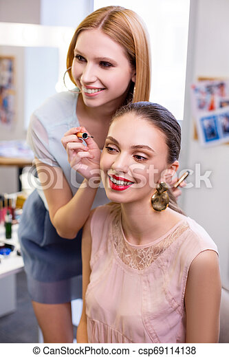 Joyful positive young woman enjoying her eyelashes - csp69114138