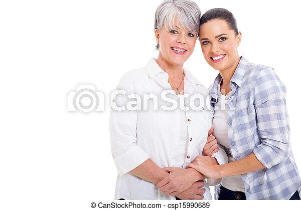 joyful senior mother and young adult daughter - csp15990689