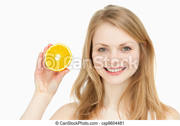 Joyful woman presenting an orange - csp9604481