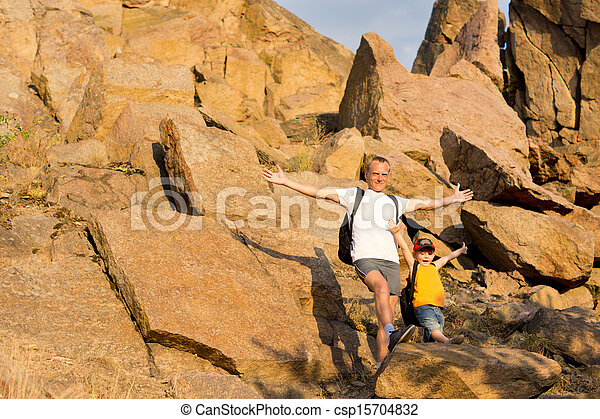 Jubilant father and son on a mountainside - csp15704832