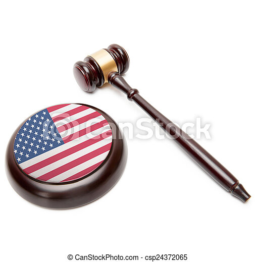 Judge gavel and soundboard with national flag on it - United States - csp24372065