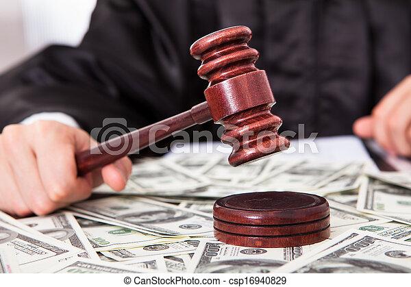 Judge Hitting Mallet On Dollar - csp16940829