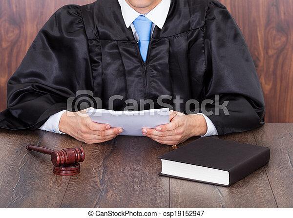 Judge Holding Documents - csp19152947