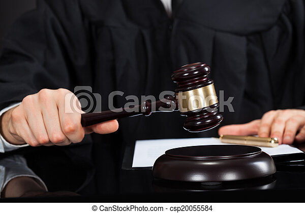 Judge With Mallet At Desk - csp20055584