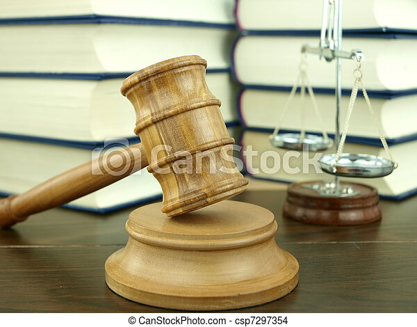Judge?s Gavel and scale of justice with a stack of legal books background - csp7297354