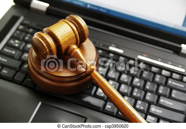 judges gavel on a laptop computer (cyber law) - csp3950620