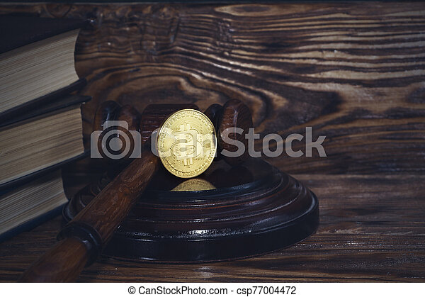 judge's hammer and bitcoin gold coin. Digital currency. - csp77004472