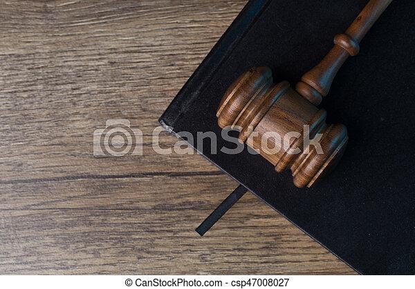 Judge's hammer on black notebook - csp47008027
