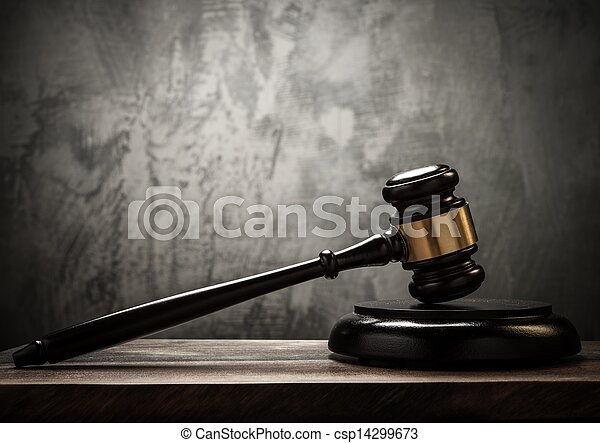 Judge's hammer on wooden table  - csp14299673