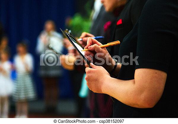 Judges making marks - csp38152097