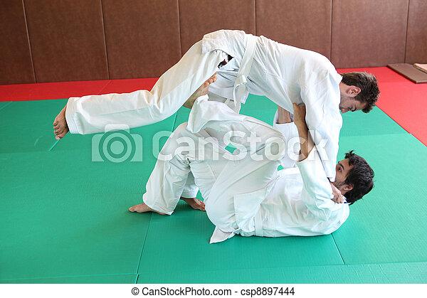 Judo hold down. - csp8897444