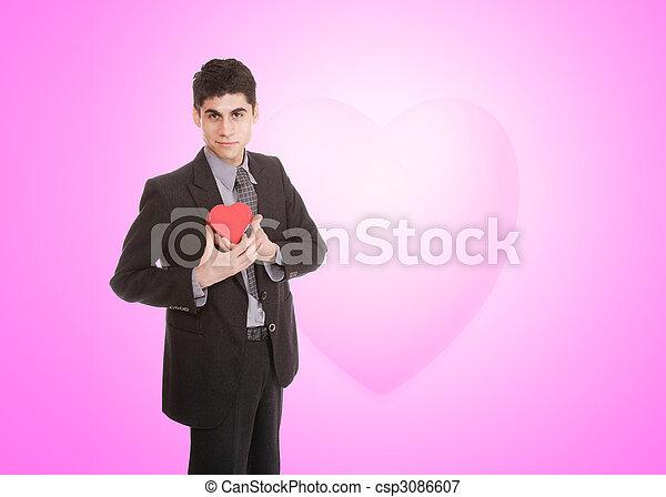 Un joven apuesto vestido de corazón - csp3086607