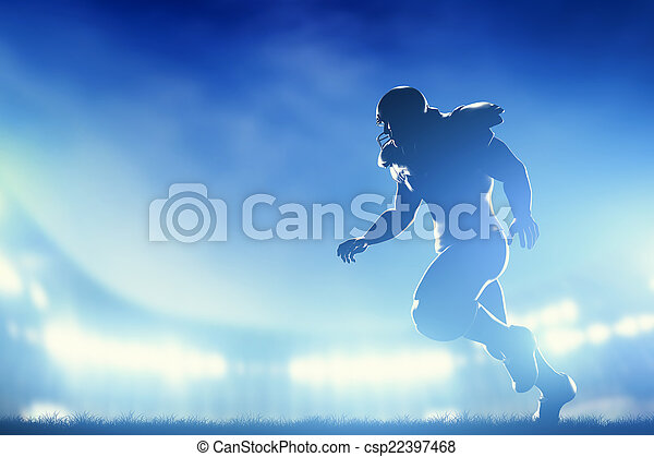 Jugadores de fútbol americano en juego, corriendo. Luces de estadio - csp22397468