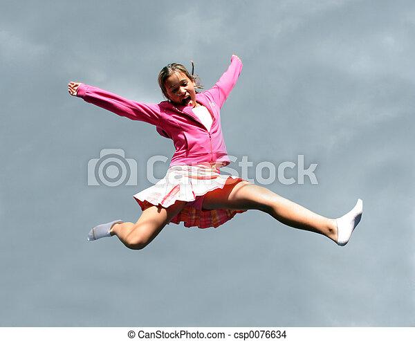 Jumping happy girl - csp0076634