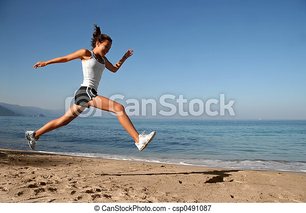 Jumping on the beach - csp0491087