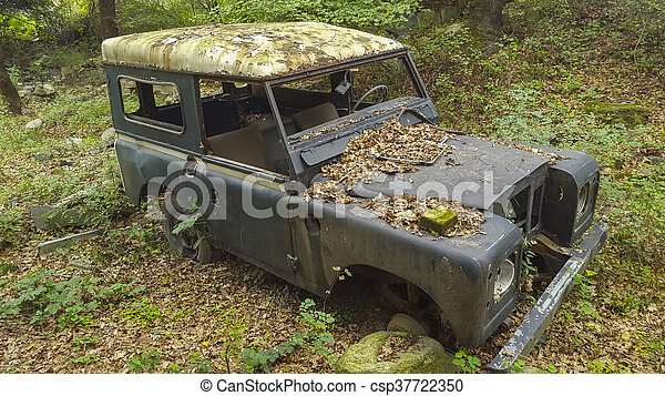 Junk Car In Woods Old Rusted Jeep In Woods