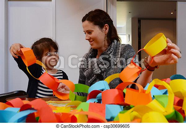 Madre e hijo preparando una decoración manual juntos - csp30699605