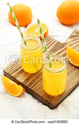 jus orange, planche découper, bouteille - csp41063883