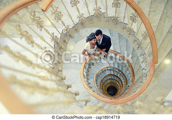 Just married couple in a spiral staircase - csp18914719