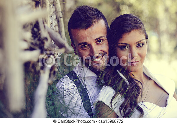 Just married couple in nature background - csp15968772
