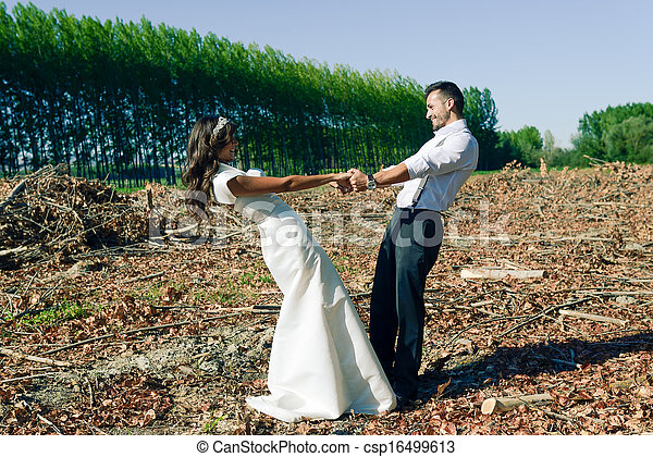 Just married couple in poplar background - csp16499613