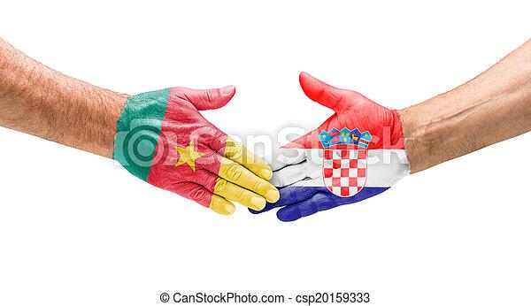 Handshake Kamroon und Croatia - csp20159333