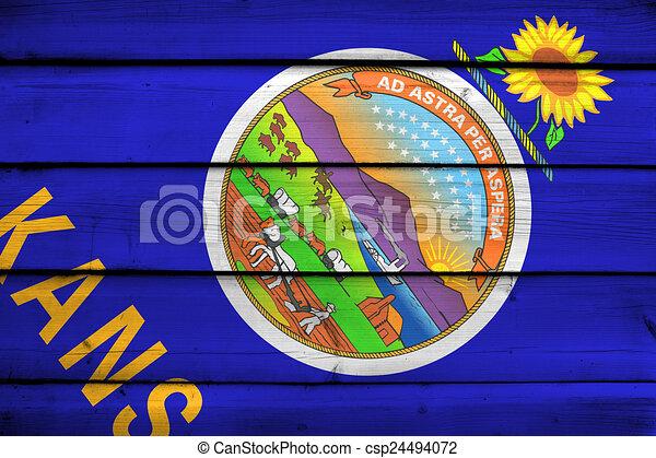 kansas state flag on wood background