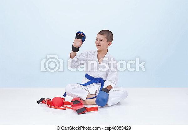 Karate boy in karategi raised his hand in greeting karate boy in karategi raised his hand in greeting csp46083429 m4hsunfo