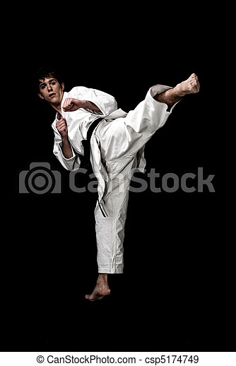Karate male fighter young high contrast on black background. - csp5174749