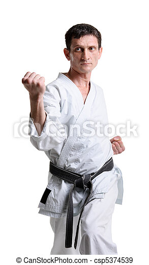 Karate. Man in a kimono with a white background - csp5374539