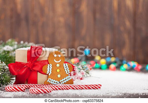 kasten, stöcke, geschenk, zuckerl, lebkuchen, weihnachten, mann - csp63375824